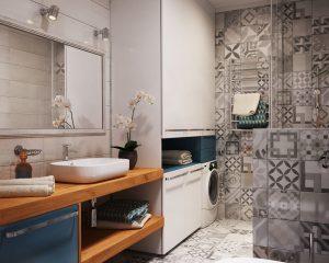 washing machine in bathroom under cupboard