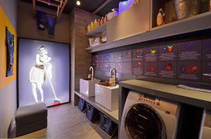 Washing machine in bathroom under custom shelves